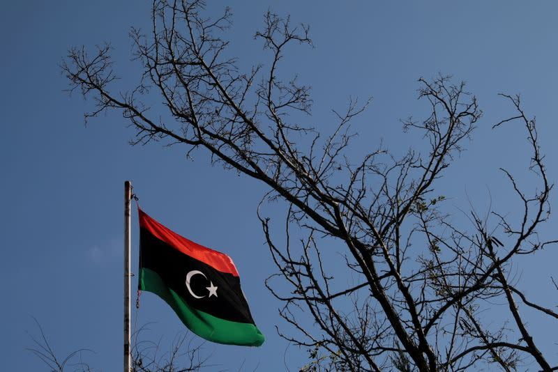 FILE PHOTO: A Libyan flag flutters atop the Libyan Consulate in Athens