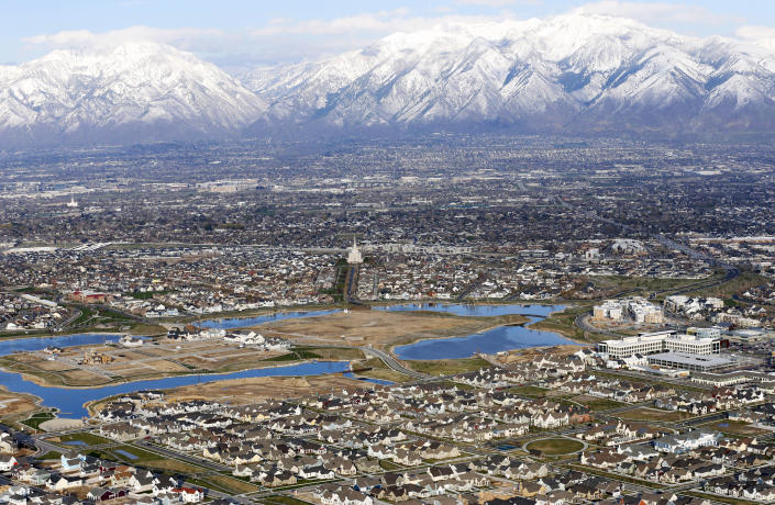 FILE - Homes, in suburban Salt Lake City, are shown on April 13, 2019. Utah is one of two Western states known for rugged landscapes and wide-open spaces that are bucking the trend of sluggish U.S. population growth. The boom there and in Idaho are accompanied by healthy economic expansion, but also concern about strain on infrastructure and soaring housing prices. (AP Photo/Rick Bowmer, File)