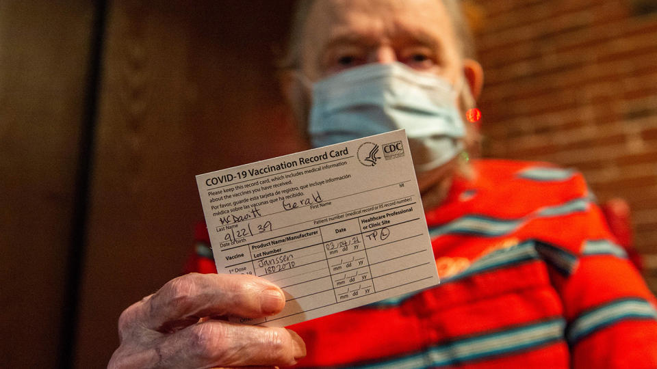 Gerald McDavitt, 81, a Veteran of the United States Army Corps of Engineers, holds his CDC vaccine card after being inoculated with the Johnson & Johnson Covid-19 Janssen Vaccine at his home in Boston, Massachusetts on March 4, 2021. (Joseph Prezioso/AFP via Getty Images)