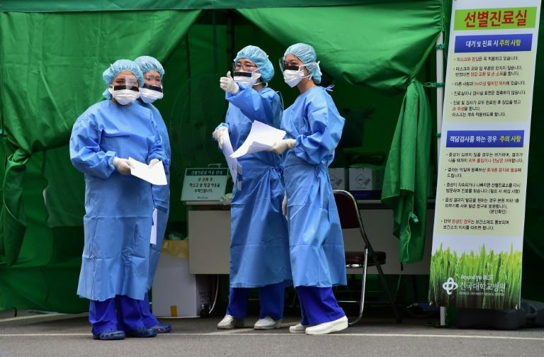 Medical workers in protective gear gather at a separated clinic center for MERS patients, at Konkuk University Hospital in Seoul, in June 2015