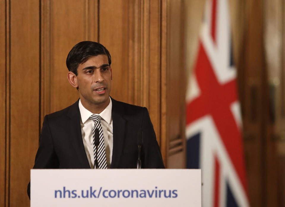 Britain's Chancellor Rishi Sunak gives a press conference about the ongoing situation with the COVID-19 coronavirus outbreak inside 10 Downing Street in London, Tuesday, March 17, 2020. For most people, the new coronavirus causes only mild or moderate symptoms, such as fever and cough. For some, especially older adults and people with existing health problems, it can cause more severe illness, including pneumonia. (AP Photo/Matt Dunham, Pool)
