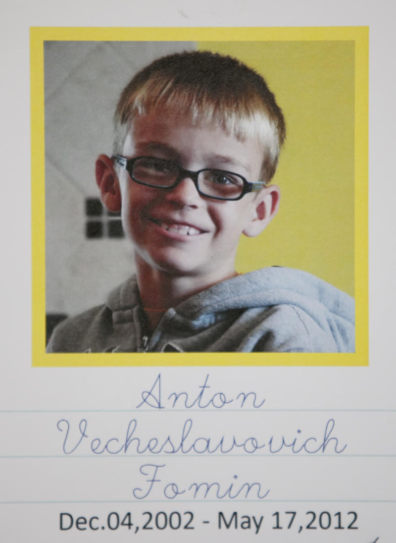 This undated photo provided by the Sinchuk family, and printed on a written obituary, shows Anton Fomin, a 9-year-old Russian boy who was killed in a Nebraska house fire on May 17. Nearly 200 people gathered at a church in Lincoln, Neb.,  on Wednesday to mourn Anton Fomin, who was living with the Sinchuks, who were his legal guardians.  (AP Photo/Nati Harnik)