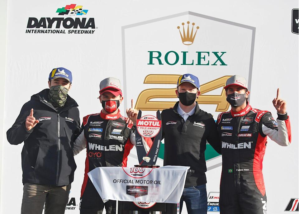 <em>Chase Elliott (left), celebrates with Action Express Racing teammates Pipo Derani, Mike Conway and Felipe Nasr (from left to right) after the No. 31 Cadillac won the Motul Pole Award 100 race at the Roar Before the 24 at Daytona (Nigel Cook/USA TODAY Sports Images).</em>