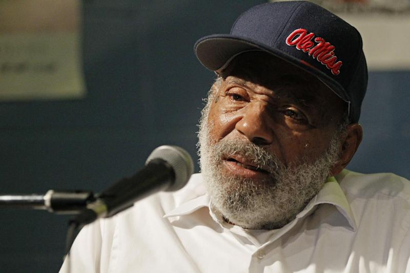 In this Aug. 14, 2012 photo James Meredith, the first black student to integrate the University of Mississippi in 1962, speaks to an audience at a reading at a Jackson, Miss., book store. Meredith's current book outlines his impression of race relations, integration and the statue the university erected to commemorate his integration of the liberal arts school. (AP Photo/Rogelio V. Solis)