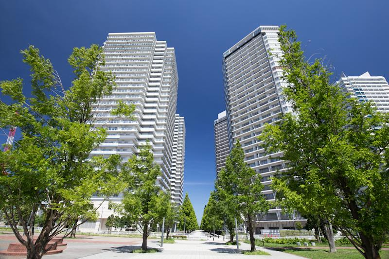 High-rise apartment buildings in urban setting.