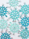 """<p>These DIY snowflake garlands look ultra-posh, but they're actually super easy and affordable to make. Use a pack of wooden snowflakes from the dollar store, top with paint and adhesive rhinestones, then string together with twine.</p><p><a href=""""https://www.whitehousecrafts.net/post/2019/11/13/sparkly-snowflake-garland"""" rel=""""nofollow noopener"""" target=""""_blank"""" data-ylk=""""slk:Get the tutorial at the White House Crafts"""" class=""""link rapid-noclick-resp""""><em>Get the tutorial at the White House Crafts</em></a></p>"""