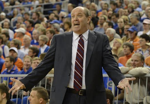 Vanderbilt head coach Kevin Stallings questions a call from the referee during the first half of an NCAA college basketball game against Florida in Gainesville, Fla., Wednesday, March 6, 2013. (AP Photo/Phil Sandlin)