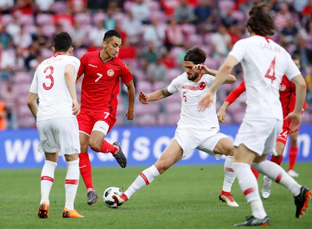 Soccer Football - International Friendly - Tunisia vs Turkey - Stade de Geneve, Geneva, Switzerland - June 1, 2018 Tunisia's Saif-Eddine El Khaoui in action with Turkey's Okay Yokuslu REUTERS/Denis Balibouse