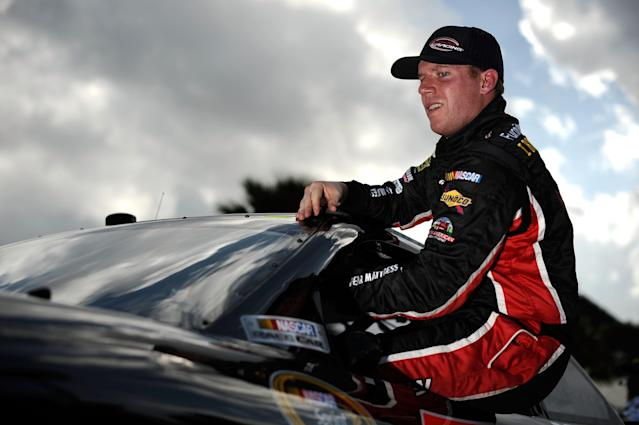 DAYTONA BEACH, FL - FEBRUARY 19: Regan Smith, driver of the #78 Furniture Row/CSX Chevrolet, climbs from his car after qualifying for the NASCAR Sprint Cup Series Daytona 500 at Daytona International Speedway on February 19, 2012 in Daytona Beach, Florida. (Photo by Jared C. Tilton/Getty Images for NASCAR)