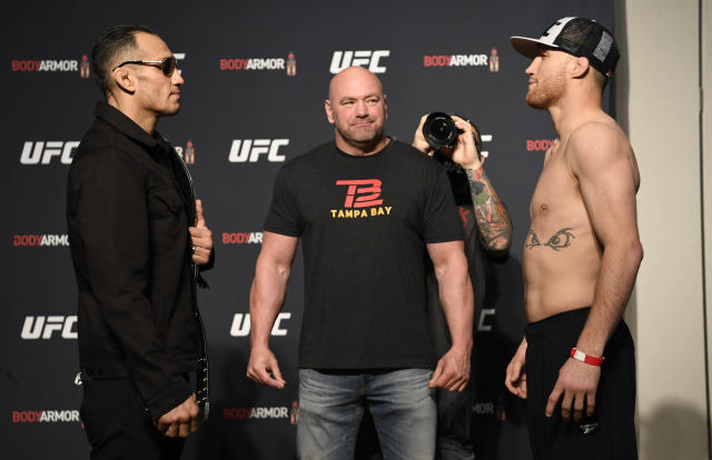 Tony Ferguson (L) and Justin Gaethje face off during the UFC 249 official weigh-in Friday in Jacksonville, Florida. (Photo by Mike Roach/Zuffa LLC)