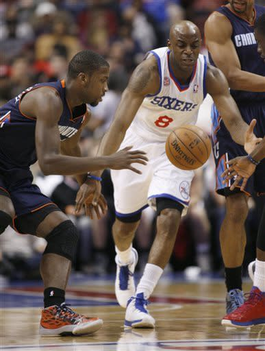 Charlotte Bobcats' Michael Kidd-Gilchris, left and Philadelphia 76ers' Damien Wilkins (8) chase the loose ball in the first half of an NBA basketball game, Saturday, March 30, 2013, in Philadelphia. (AP Photo/H. Rumph Jr)