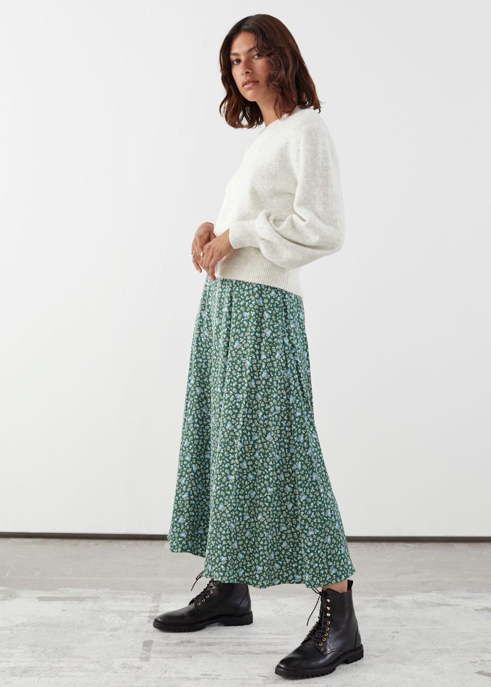 "<br><br><strong>& Other Stories</strong> Viscose Midi Skirt, $, available at <a href=""https://go.skimresources.com/?id=30283X879131&url=https%3A%2F%2Fwww.stories.com%2Fen_usd%2Fclothing%2Fskirts%2Fmidi-skirts%2Fproduct.viscose-midi-skirt-green.0868945003.html"" rel=""nofollow noopener"" target=""_blank"" data-ylk=""slk:& Other Stories"" class=""link rapid-noclick-resp"">& Other Stories</a>"