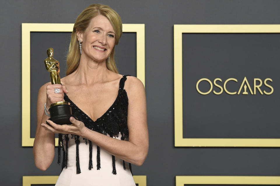"""Laura Dern, winner of the award for best performance by an actress in a supporting role for """"Marriage Story"""", poses in the press room at the Oscars on Sunday, Feb. 9, 2020, at the Dolby Theatre in Los Angeles. (Photo by Jordan Strauss/Invision/AP)"""