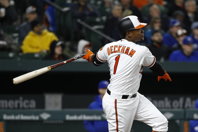Baltimore Orioles' Tim Beckham hits a sacrifice fly ball in the fourth inning of a baseball game against the Toronto Blue Jays, Wednesday, April 11, 2018, in Baltimore. Pedro Alvarez scored on the play. (AP Photo/Patrick Semansky)