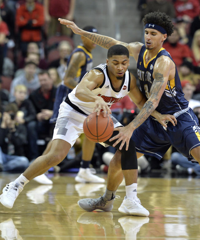 Louisville guard Christen Cunningham (1) attempts to get past the defense of Kent State forward Akiean Frederick (3) during the first half of an NCAA college basketball game in Louisville, Ky., Saturday, Dec. 15, 2018. (AP Photo/Timothy D. Easley)