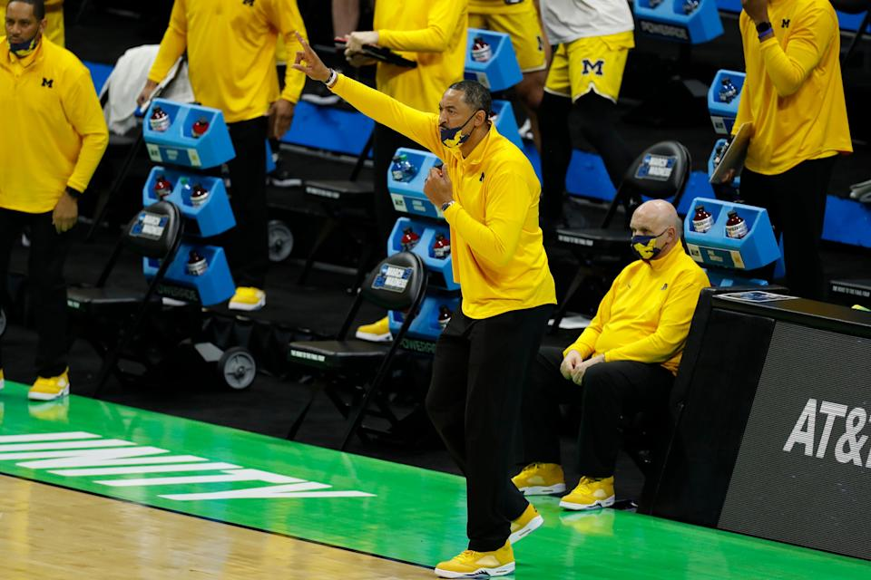 Michigan Wolverines head coach Juwan Howard calls a play from the sidelines during the first half in the second round of the 2021 NCAA tournament against the Louisiana State Tigers at Lucas Oil Stadium on March 22, 2021.
