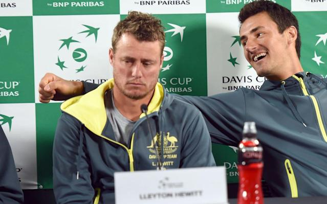 The animosity between Hewitt (left) and Tomic has dominated the front and back pages in Australia all week - AFP