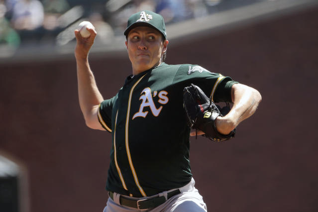 Oakland Athletics pitcher Homer Bailey throws to a San Francisco Giants batter during the first inning of a baseball game in San Francisco, Wednesday, Aug. 14, 2019. (AP Photo/Jeff Chiu)