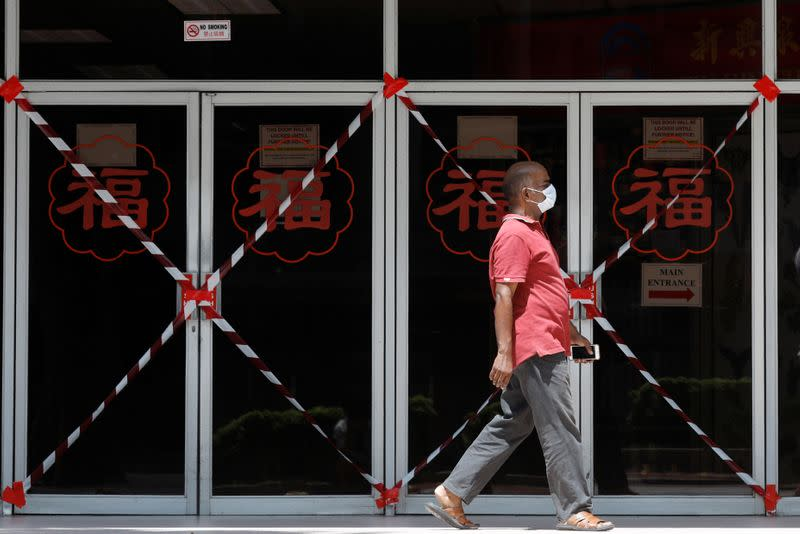 A man passes a closed off mall amid the coronavirus disease (COVID-19) outbreak in Singapore