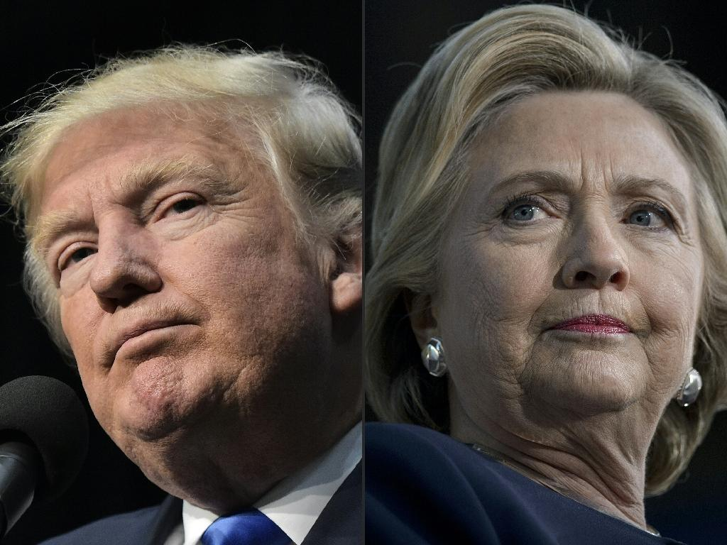 Researchers Hunt Allcott of New York University and Matthew Gentzkow of Stanford concluded that despite the widespread consumption of fake stories, this was not likely a determining factor in Donald Trump's victory over Hillary Clinton (AFP Photo/Mandel NGAN, Brendan Smialowski)