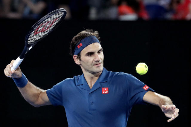 Switzerland's Roger Federer celebrates after defeating Uzbekistan's Denis Istomin during their first round match at the Australian Open tennis championships in Melbourne, Australia, Monday, Jan. 14, 2019. (AP Photo/Aaron Favila)