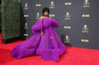 Can you say red carpet glamour? Nicole brought the brightness with her ruffled purple off-the-shoulder gown by Christian Siriano. The look exuded fun and fabulousness — just like Nicole herself.