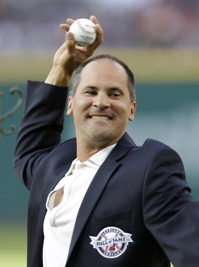 Former Cleveland Indians player Omar Vizquel throws out the ceremonial first pitch before a baseball game between the Detroit Tigers and the Indians, Saturday, June 21, 2014, in Cleveland. Vizquel was inducted into the Indians Hall Of Fame Saturday. (AP Photo/Tony Dejak)
