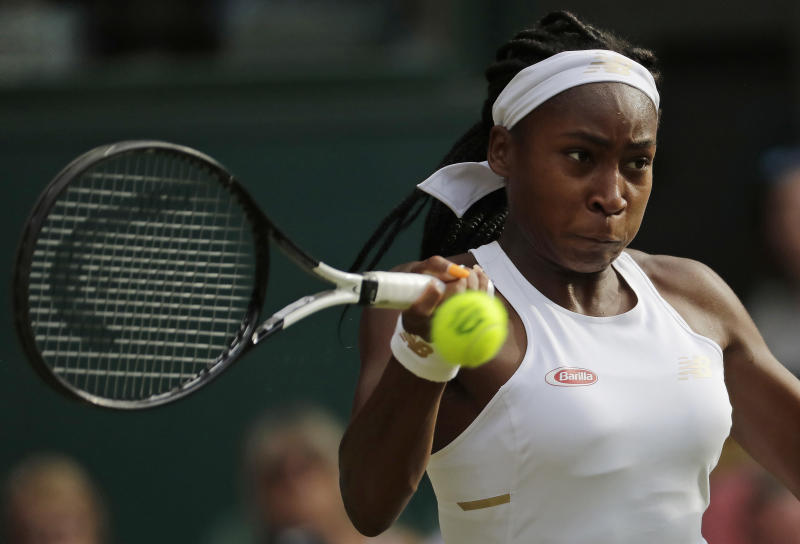 "United States' Cori ""Coco"" Gauff returns to Slovenia's Polona Hercog in a Women's singles match during day five of the Wimbledon Tennis Championships in London, Friday, July 5, 2019. (AP Photo/Ben Curtis)"