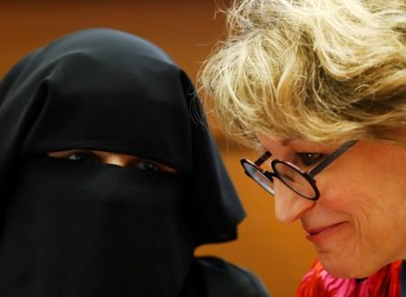 """Agnes Callamard, U.N. special rapporteur listens to Yumna Desai during a side event called """"Silencing Dissident"""" during the Human Rights Council at the United Nations in Geneva"""