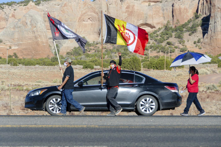 In this image provided by the Navajo Nation Office of the Speaker, family members and advocates participating in a walk on the Navajo Nation, Wednesday, May 5, 2021, near Window Rock, Ariz., to commemorate a day of awareness for the crisis of violence against Indigenous women and children. (Byron C. Shorty, Navajo Nation Office of the Speaker via AP)