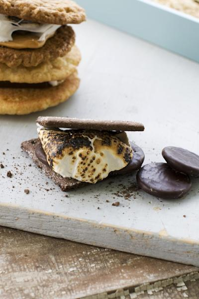 In this image taken on April 29, 2013, front, a double chocolate grasshopper s'more, top left, a salted oatmeal s'more, and a toasted mocha s'more are shown in Concord, N.H. (AP Photo/Matthew Mead)