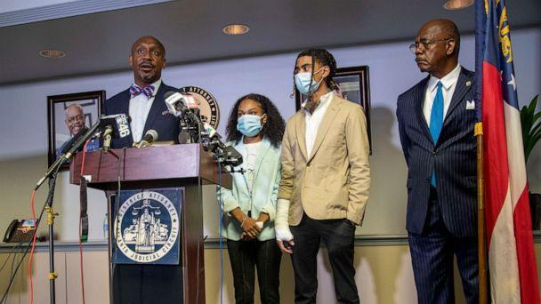 PHOTO: Attorney Mawuli Davis, left, speaks on behalf of Taniyah Pilgrim, center, and Messiah Young, right, during a press conference by the Fulton County District Attorney's Office in Atlanta, June 2, 2020. (Alyssa Pointer/Atlanta Journal-Constitution via AP, FILE)