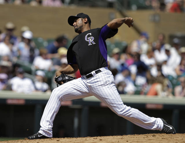 Colorado Rockies starting pitcher Franklin Morales throws during the first inning of a spring exhibition baseball game against the Seattle Mariners, Saturday, March 29, 2014, in Scottsdale, Ariz. (AP Photo/Darron Cummings)