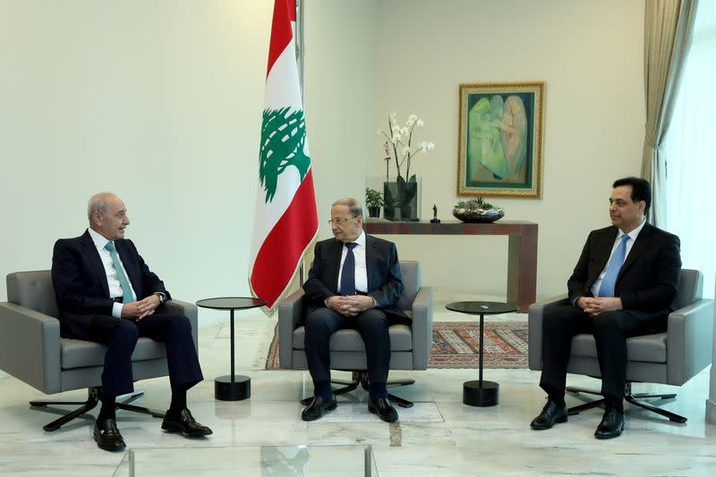 Lebanon's President Michel Aoun meets with Prime Minister Hassan Diab and Parliament Speaker Nabih Berri at the presidential palace in Baabda