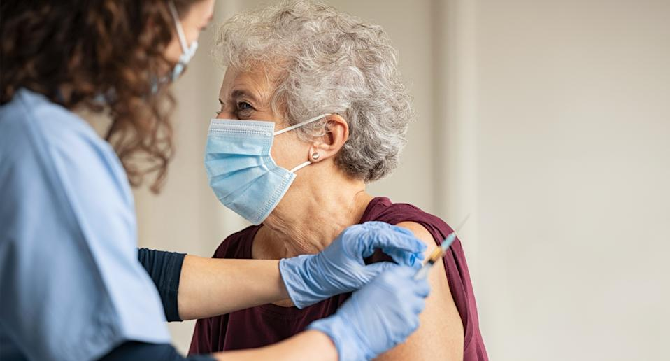 An elderly person receiving the Covid-19 vaccination