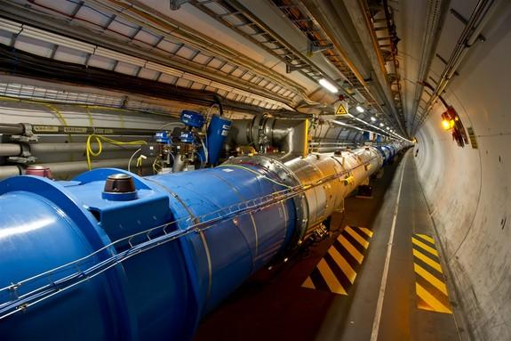 This photo shows the tunnel of the Large Hadron Collider, where beams of particles pass through the central pipes before colliding with each other.