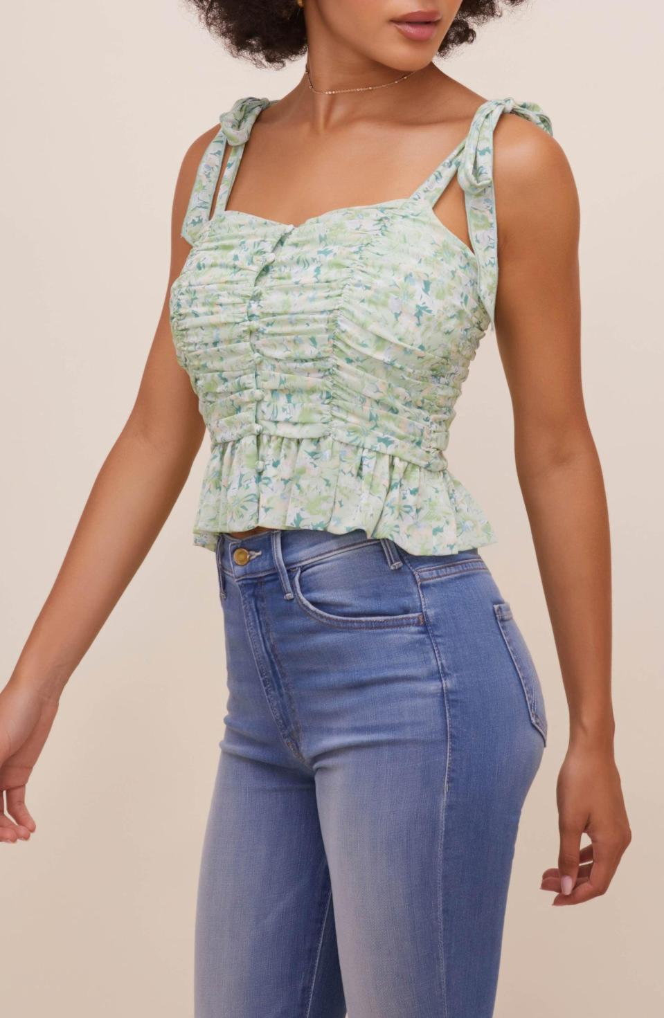 <p>This <span>ASTR the Label Tie Shoulder Peplum Crop Tank</span> ($88) is a fun and playful choice for summer picnics.</p>