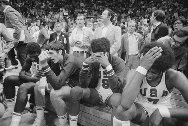 (Original Caption) Dejected. Munich, West Germany: Dejected members of American basketball team sit on their bench after losing close game to USSR, in Olympic basketball final here. Players include (LTR): Jim Brewer, Bob Jones, Dwight Jones, and Mike Banton. (Photo: Bettmann via Getty Images)