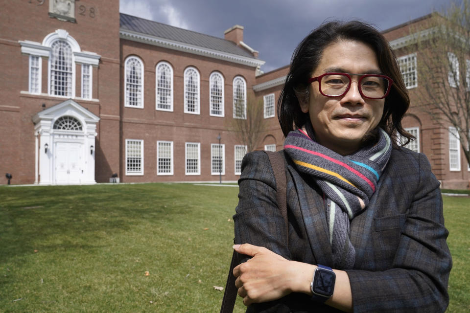 Eng-Beng Lim, a professor at Dartmouth College, stands for a photograph on the school's campus, Tuesday, April 20, 2021, in Hanover, N.H. A wave of anti-Asian attacks that started more than a year ago with the pandemic, along with the March 2021 shootings in Atlanta that left six Asian women dead, have provoked national conversations about the visibility of Asian Americans. (AP Photo/Steven Senne)
