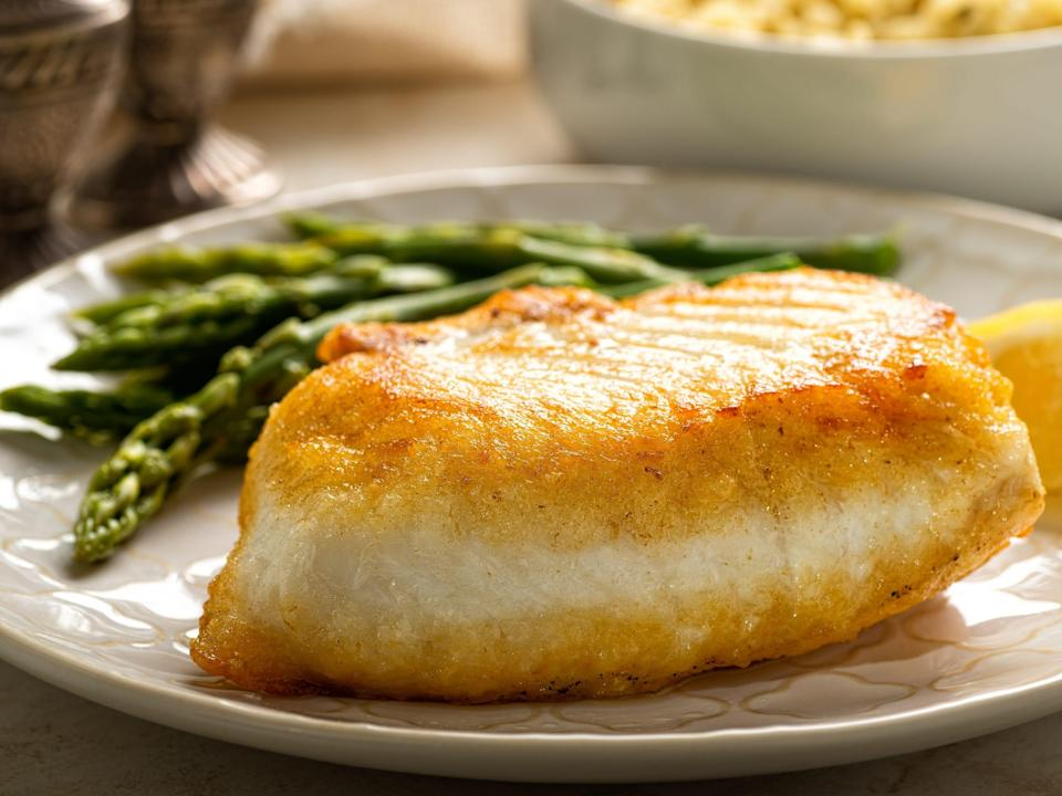 Pan seared halibut with asparagus and wild rice.