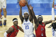 Kentucky's Isaiah Jackson (23) pulls down a rebound near Richmond's Blake Francis, left, and Nathan Cayo (4) during the second half of an NCAA college basketball game in Lexington, Ky., Sunday, Nov. 29, 2020. (AP Photo/James Crisp)