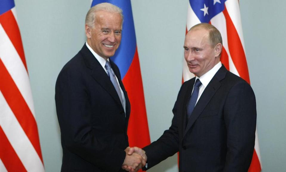 The then vice-president, Joe Biden, shakes hands with Vladimir Putin in Moscow in 2011