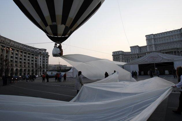 A Guinness World Record for the longest train of a wedding dress is attempted in front of the Parliament palace in Bucharest March 20, 2012. The 2,750 meter long train broke a previous record of 2,488 meters. It is made of 4,700 meters of material using 1,857 needles, taking 100 days to made. REUTERS/Bogdan Cristel