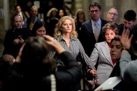 FILE PHOTO: Summer Zervos, a former contestant on The Apprentice, leaves New York State Supreme Court with attorney Gloria Allred, after a hearing on the defamation case against U.S. President Donald Trump in Manhattan, New York City, U.S., December 5, 2017. REUTERS/Andrew Kelly/File Photo