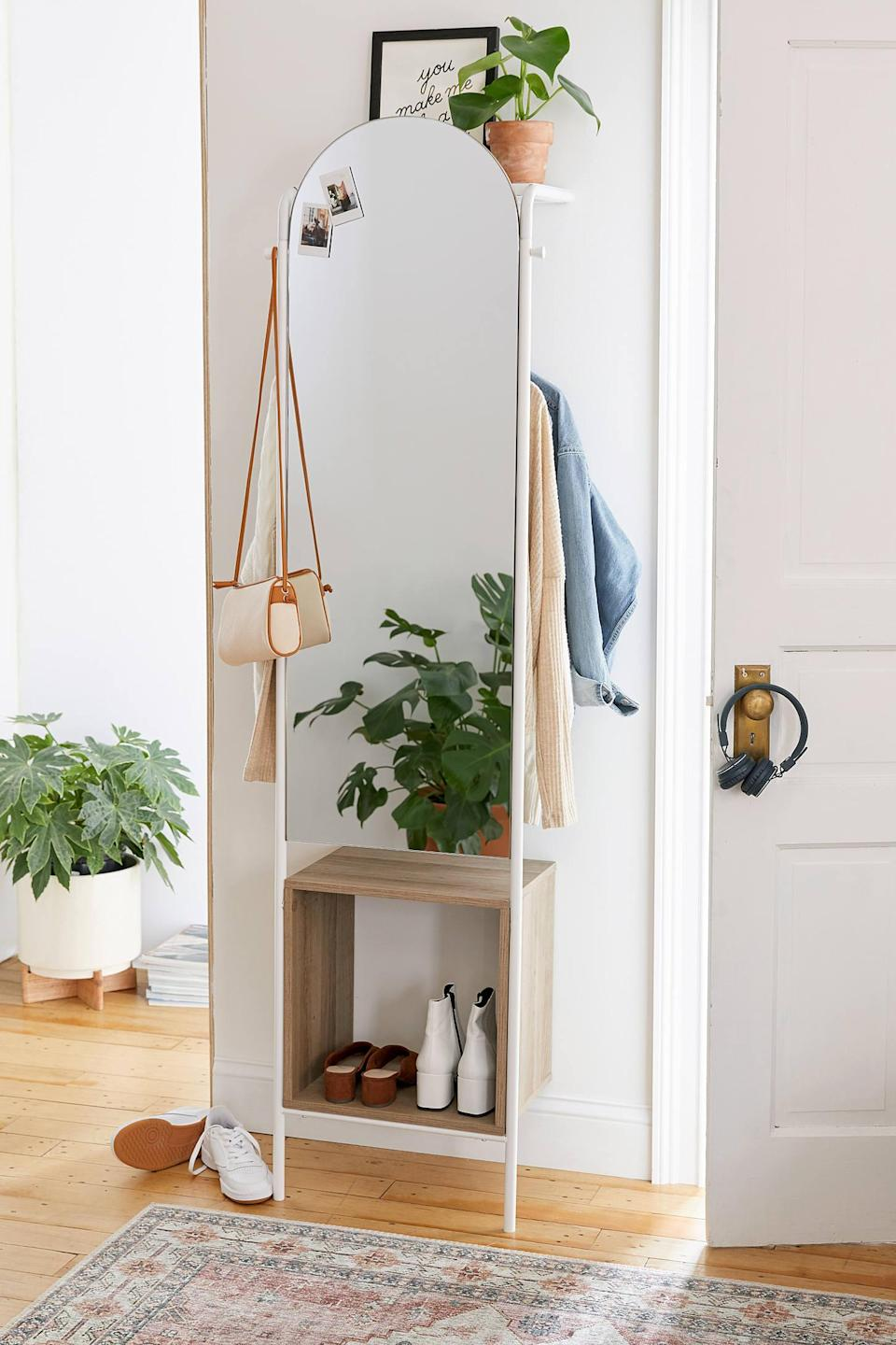 """<h2>Urban Outfitters Rooney Entryway Storage Mirror</h2><br>It's a mirror! A hanging planter! Coat storage! A shoe rack! And whether you use it as foyer organization, a bedroom staple, or sitting room decor, it's as aesthetically pleasing as it is handy. <br><br><strong>Urban Outfitters</strong> Rooney Entryway Storage Mirror, $, available at <a href=""""https://go.skimresources.com/?id=30283X879131&url=https%3A%2F%2Fwww.urbanoutfitters.com%2Fshop%2Frooney-entryway-storage-mirror%3Fcategory%3Dmirrors%26color%3D010%26type%3DREGULAR%26size%3DONE%2520SIZE%26quantity%3D1"""" rel=""""nofollow noopener"""" target=""""_blank"""" data-ylk=""""slk:Urban Outfitters"""" class=""""link rapid-noclick-resp"""">Urban Outfitters</a>"""
