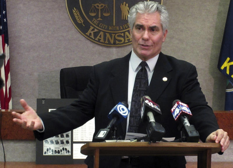 """FILE - In a Dec. 18, 2012 file photo, Kyle Smith, deputy director of the Kansas Bureau of Investigation, during a news conference in Lansing, Kan., discusses the exhumation of the remains of Richard Hickock and Perry Smith who were executed for the 1959 multiple murders that inspired Truman Capote's true-crime book, """"In Cold Blood."""" Smith said Wednesday, May 29, 2013, that DNA testing so far has been inconclusive on whether two men can also be linked to the unsolved murders of a Florida family weeks later. Smith said the agency will continue testing material collected from the remains of the convicted murderers. The KBI initially projected it would have definitive results from the DNA early this month, but the agency now has no timetable for when the testing will be complete. (AP Photo/John Hanna, File)"""