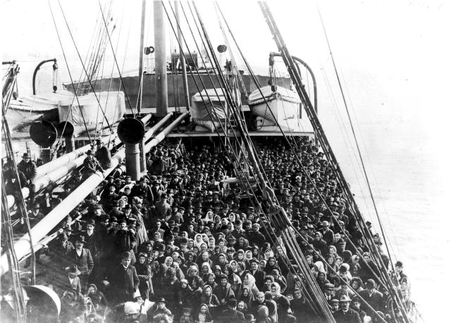 <p>Immigrants pack the upper deck of the liner SS Patricia as it travels from Hamburg, Germany, to New York, Dec. 10, 1906. (Photo: Edwin Levick/FPG/Getty Images) </p>