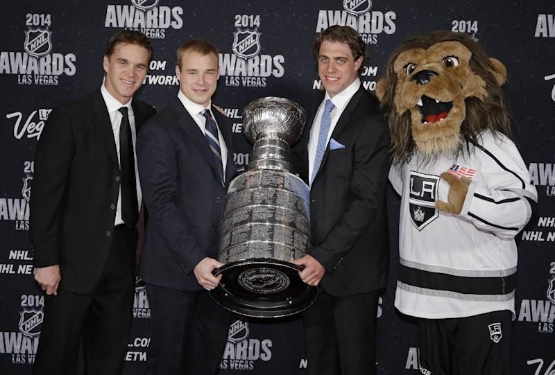From left, Luc Robitaille, Dustin Brown, and Anze Kopitar and the mascot of the Los Angeles Kings pose with the Stanley Cup on the red carpet before the NHL Awards on Tuesday, June 24, 2014, in Las Vegas. (AP Photo/John Locher)