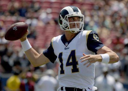 FILE PHOTO: Aug 18, 2018; Los Angeles, CA, USA; Los Angeles Rams quarterback Sean Mannion (14) looks to pass against the Oakland Raiders in the first quarter during a preseason game at Los Angeles Memorial Coliseum. Mandatory Credit: Kirby Lee-USA TODAY Sports
