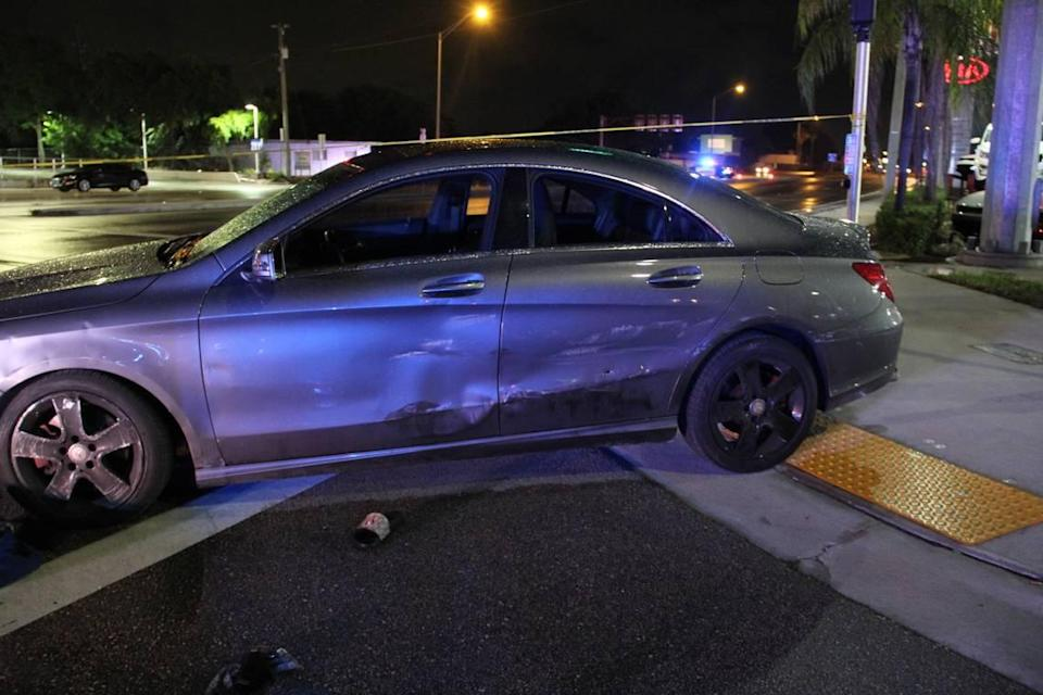 A crime-scene photo of the Mercedes-Benz believed shot at during a police chase in April 2021. What appears to be a bullet hole is in the driver's side rear door.